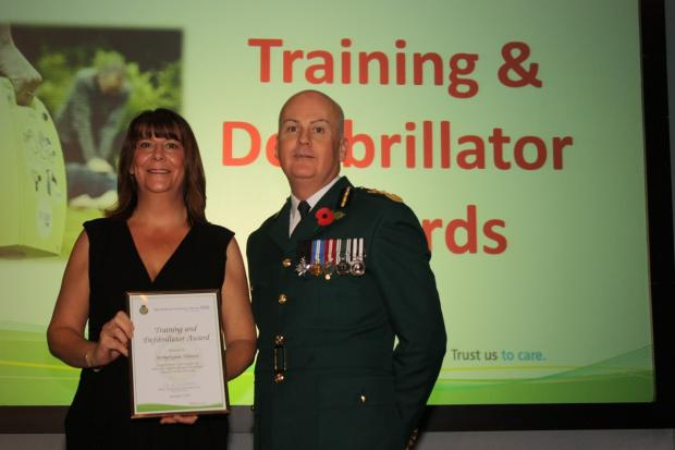 Evesham Journal: DESERVED: Arrhythmia Alliance's campaign leader Caroline Holmes and Anthony Marsh, chief executive of West Midlands Ambulance Service. Picture by West Midlands Ambulance Service.