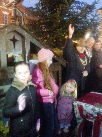 ON THE BUTTON: The young Christmas card competition winners helped light up Pershore's festive lights with the town mayor.