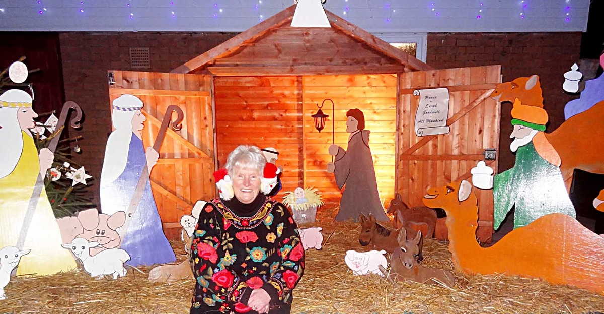 TRADITIONAL: Diana Raphael in front of the nativity scene which she made for Hampton Ferry's festive display.