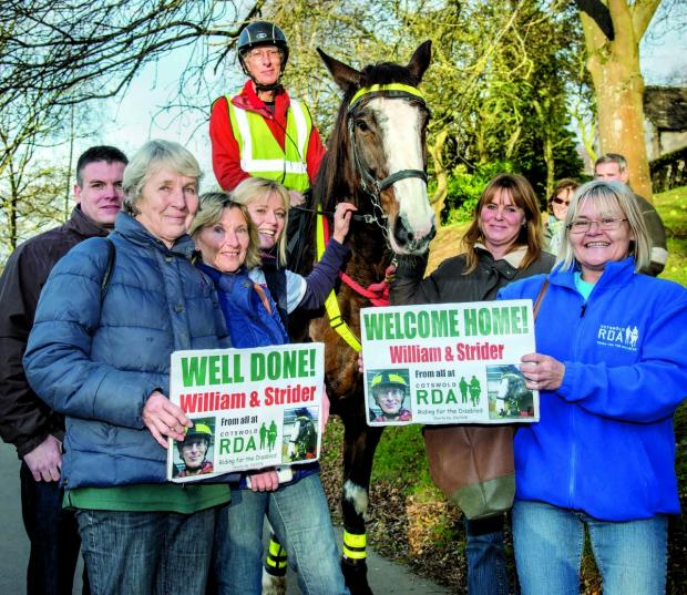WELL DONE BOTH: William Reddaway and his horse Strider are welcomed home by supporters from Cotswold Riding for the Disabled following their 2,500-mile journey across England.