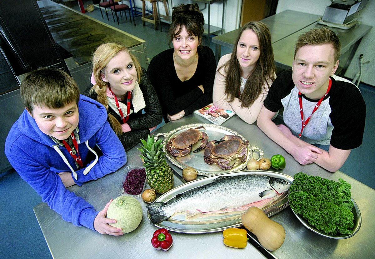 HELP: Sally Bee (centre) shares tips for healthy menu planning with Stratford College students Alex Harrison, Shannon Sutton, of Chipping Campden, Amy Tustain, of Shipston, and Josh Tattersall.