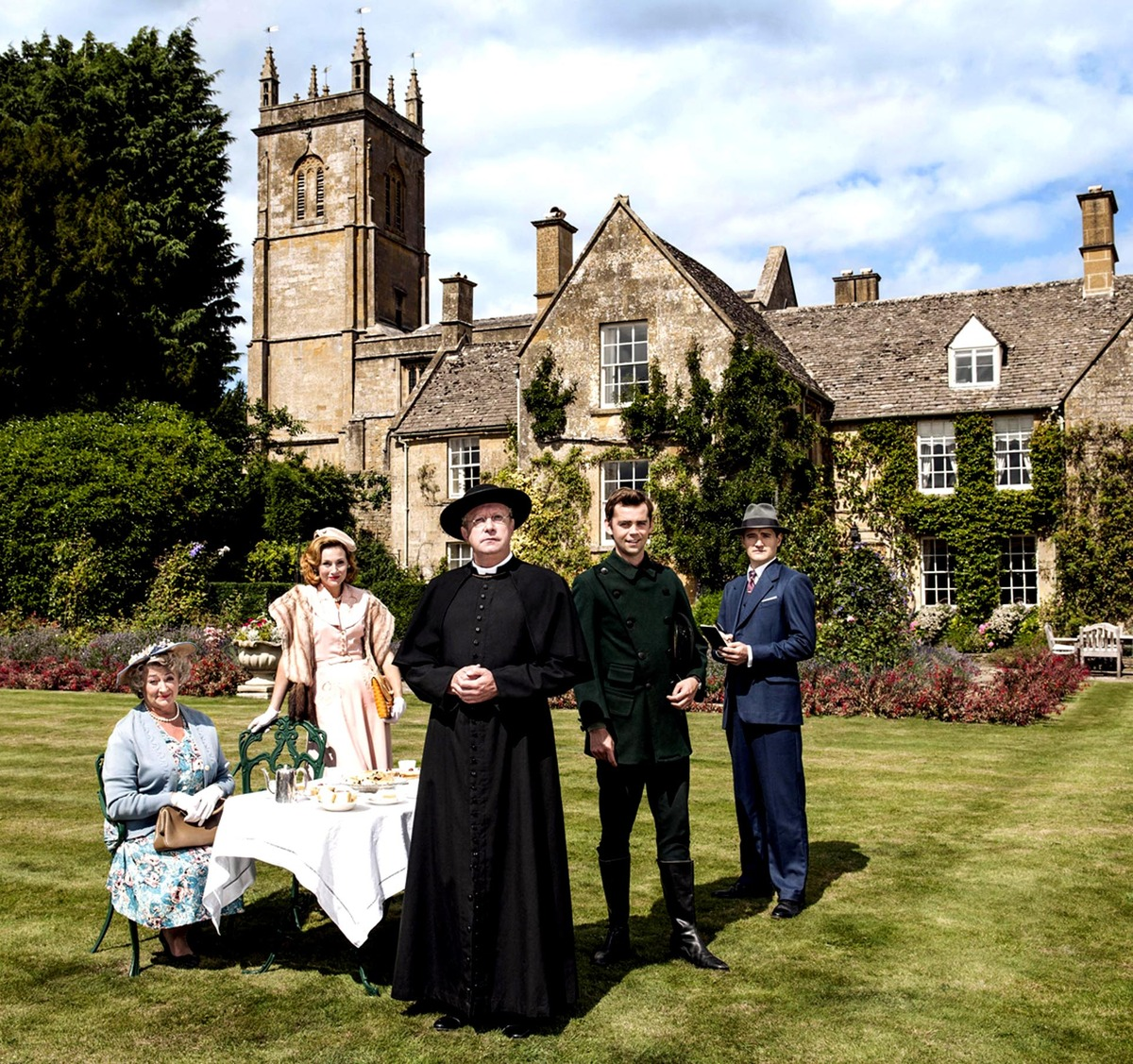 From left: Mrs McCarthy (Sorcha Cusack), Lady Felicia (Nancy Carroll), Father Brown (Mark Wiliams), Sid Carter (Alex Price) and Inspector Sullivan (Tom Chambers) in the grounds of the vicarage in Blockley – also known as Kembleford. Pic - Gary Moyes.