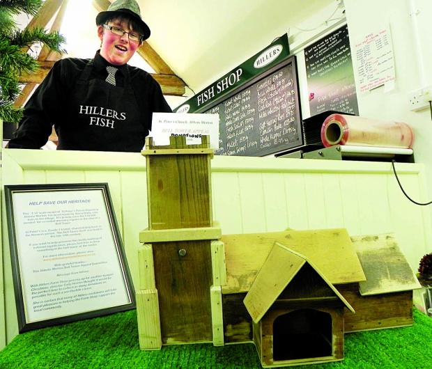 FUNDS: Harry Dyke, who helps to run Hillers Fish, with the model of Abbots Morton church.