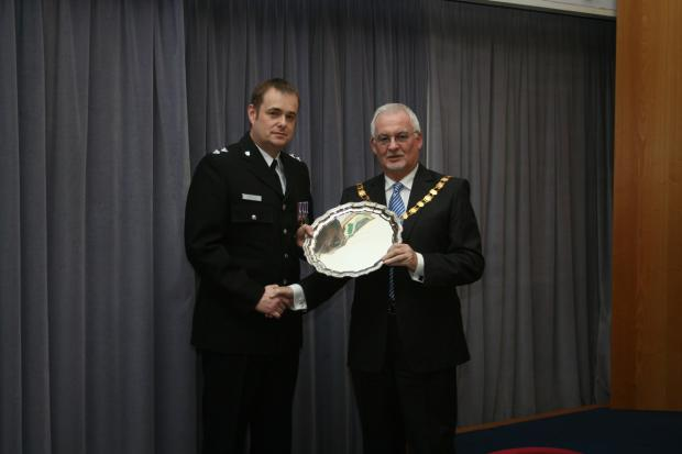 Inspector Sean Kent receives Police Trophy Award from Chairman of Wychavon District Council, Councillor Gerry O'Donnell