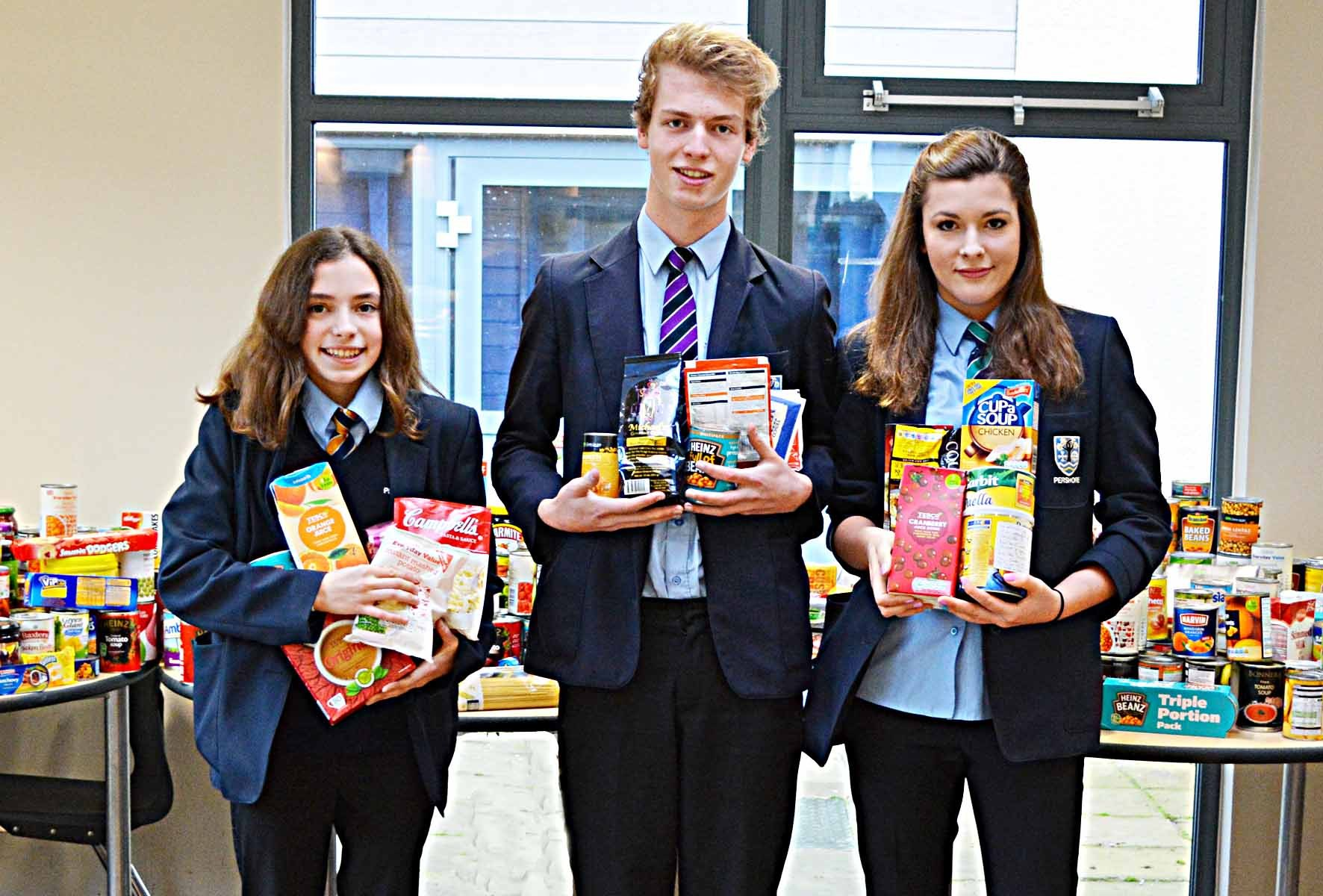 GENEROUS: Pupils at Pershore High School held a food collection in aid of Worcester Food Bank. Pictured (l-r) Rebecca Stothard, Luke Gerber and Ella Spencer.