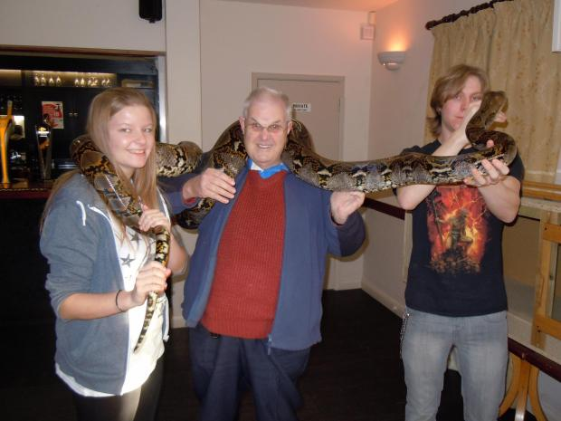 Evesham Journal: Guests got up close and personal with a reticulated python.