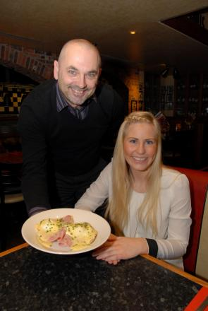Frankie and Benny's hold a charity breakfast in aid of Leukaemia dn Lymphoma Research. General manager Mike Sheridan serves up eggs benedict to Ruby Hawley, senior marketing co-ordinator.
