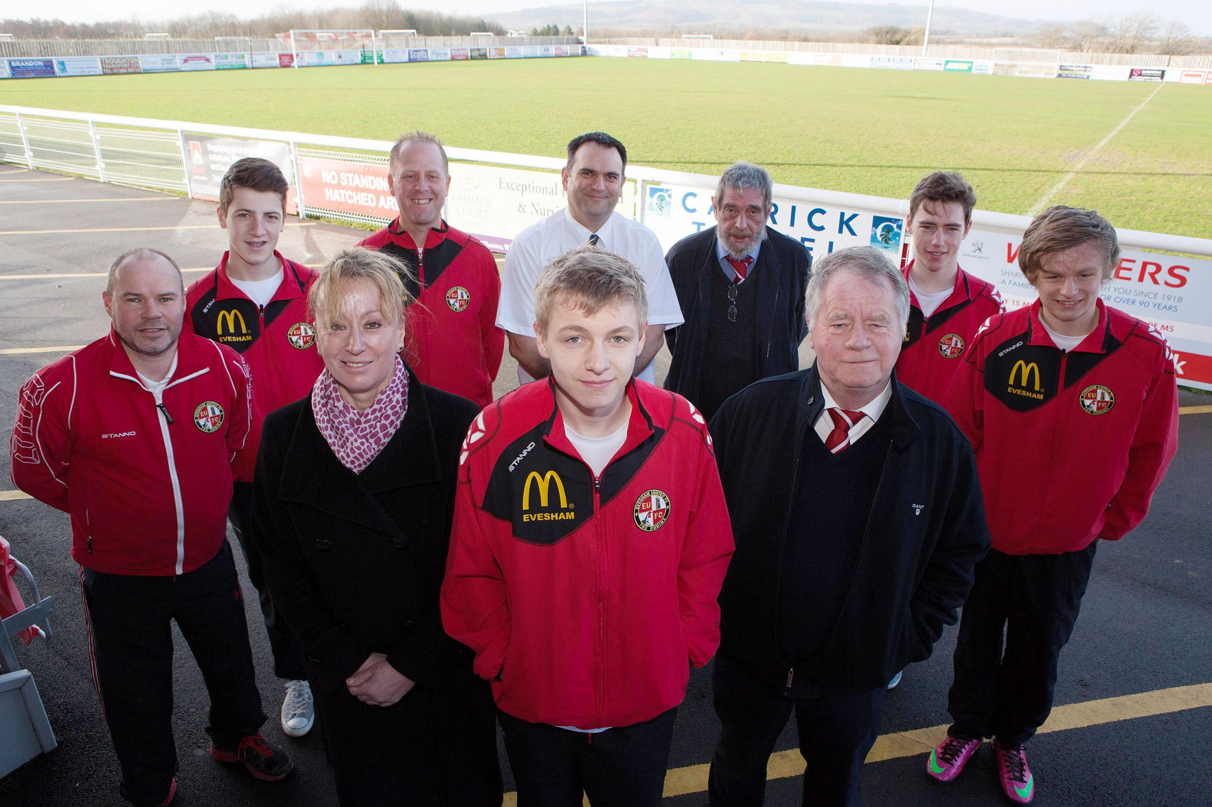 CLUB BOOST: Evesham United receive their new youth training kit from sponsors McDonald's. Front row (left to right): Mark Edwards (junior section secretary and football development officer), Sarah McLean (franchisee of McDonald's Evesham), player