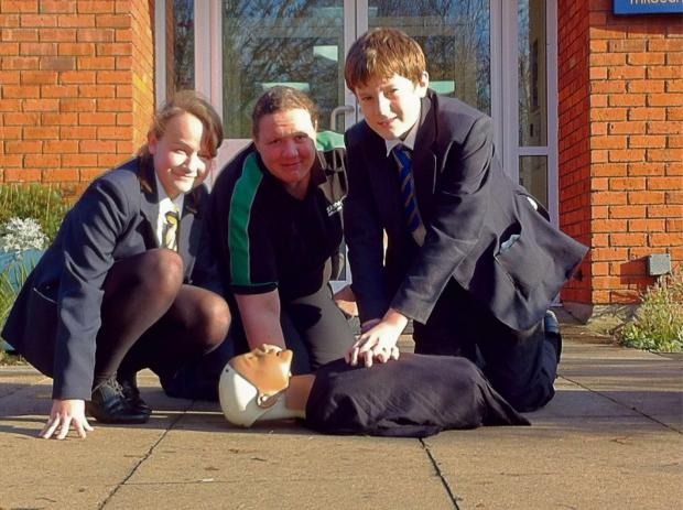 St Egwin Middle School pupils Laura Swain and George Wilson practise first aid with Jo Huck from St John Ambulance
