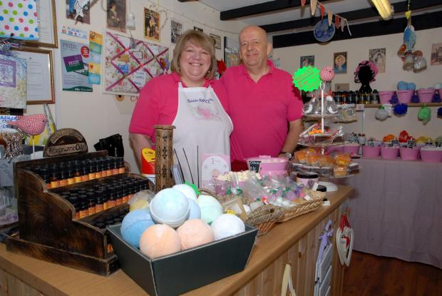 Evesham Journal: Jo and Clive Whittingham, owners of Bubble Bath Gifts in Pershore Retail Market. They are celebrating the business's first anniversary. Photo by Paul Jackson.