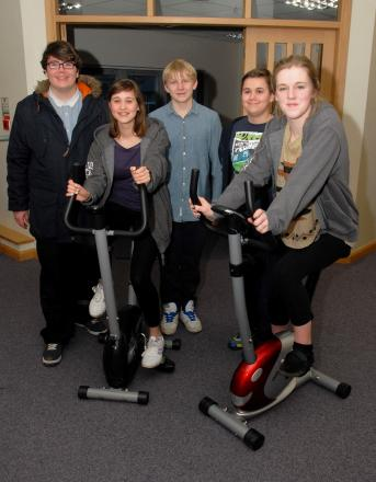 0814525601 Paul Jackson 19.02.14 Worcester A team of young people are cycling the equivelent of 6000 miles on exercise bikes to fund a trip to volunteer at an orphanage in Thailand. From left - Lewis Edwards, 17, Ellie Cave, 15, Dan Plumtree, 14, Sam Cave