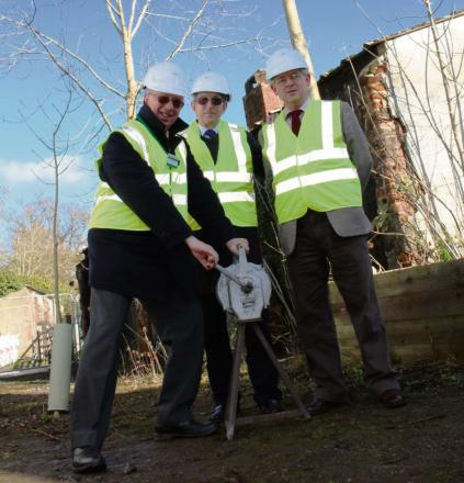 Bob Shaw (left)) and Dennis Williams (right) of Defford Airfield Heritage Group with Ian Barber of Severn Waste Services sound the air raid siren to start the restoration project