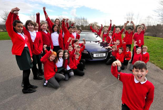 Cherry Orchard Primary School Year 6 pupil, Regan Biggerstaff and his classmates from 6SLB have an Audi R8 sports car to sell as part of a class project. Picture by John Anyon. 0914530301