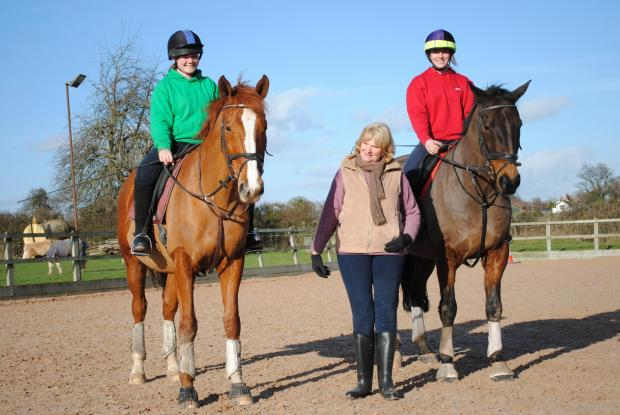 Evesham Journal: Walnut Equestrian Centre owner Jane Jones (centre) with students Annabelle Marshall and Chloe Sharman.