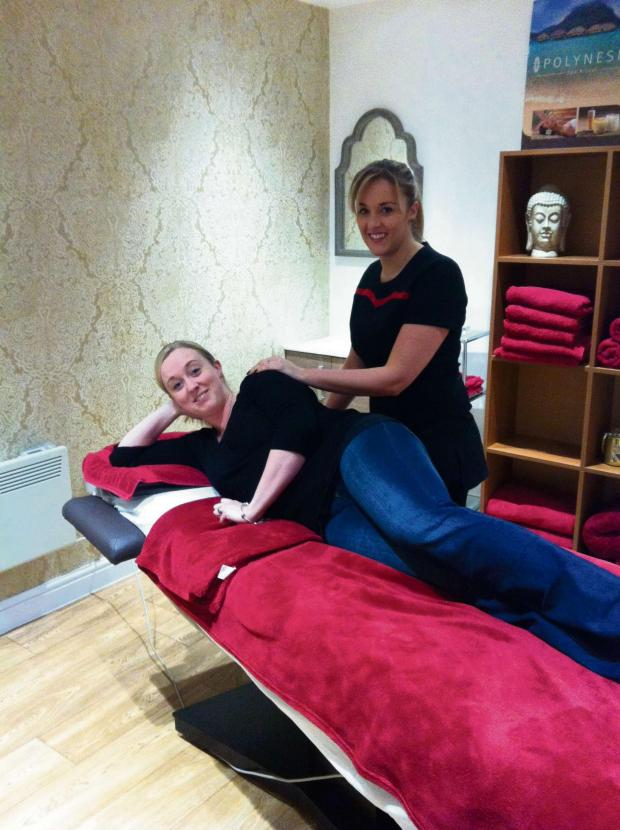 Evesham Journal: Michelle Mabbott (standing) offers a range of treatments at her new look salon near Fladbury. She is pictured here with Lucy Dolphin.