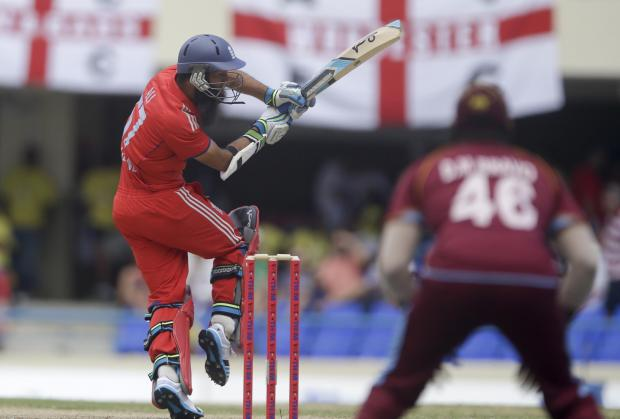 Evesham Journal: England's Moeen Ali bats during the second one-day international cricket match against West Indies at the Sir Vivian Richards Cricket Ground in St. John's, Antigua, Sunday, March 2, 2014. (AP Photo/Ricardo Mazalan). (4340592)
