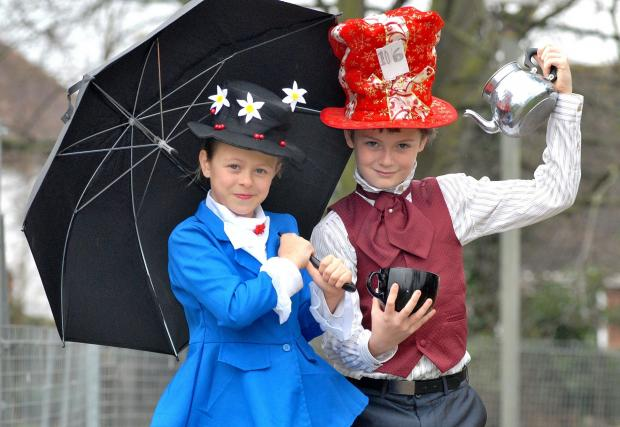 Evesham Journal: MAD HATTER: Perdiswell Primary School pupils Mia Mandrell, nine, as Mary Poppins and Ben Sparrow, 11, as the Mad Hatter, for World Book Day. Picture by Nick Toogood. 1014537801.