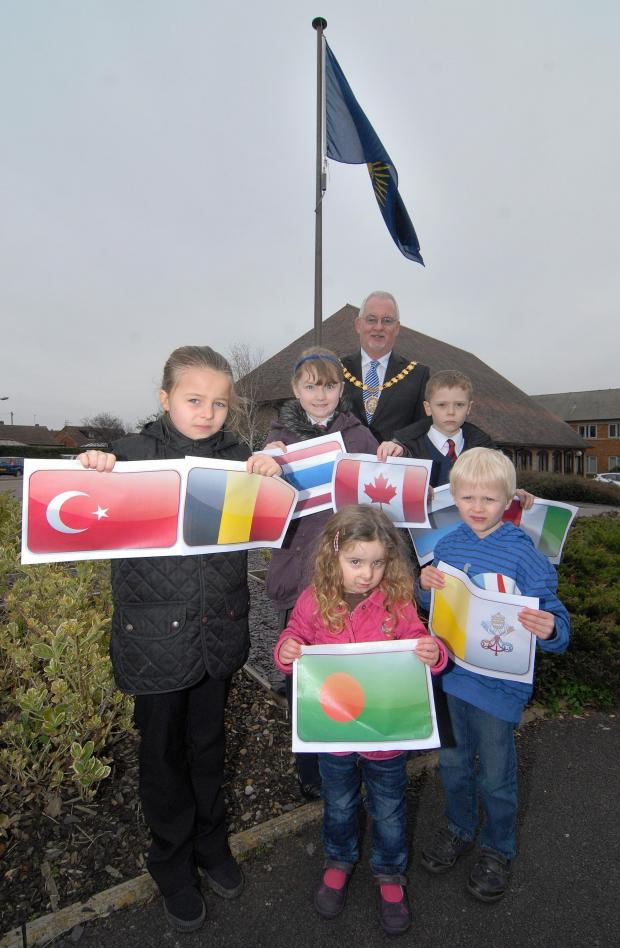 Evesham Journal: 1114540301. 10/03/14. Chairman of Wychavon District Councill Councillor Gerry O'Donnell with youngsters Chloe Poole aged 9, Holly Whittal-Jones  10 and Jamie Elsdon 9 from Westacre Middle School in Droitwich and Anya Harris aged 3 and Thomas Harrison