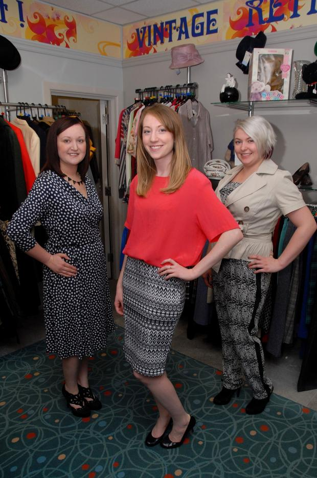 Evesham Journal: St Richard's Hospice shop in Evesham are holding a retro fashion show. From left - Nichola Bindoff,volunteer model, Sarah Patrick, organiser and  Kelly Hayward, volunteer. Photo by Paul Jackson (1114542301)