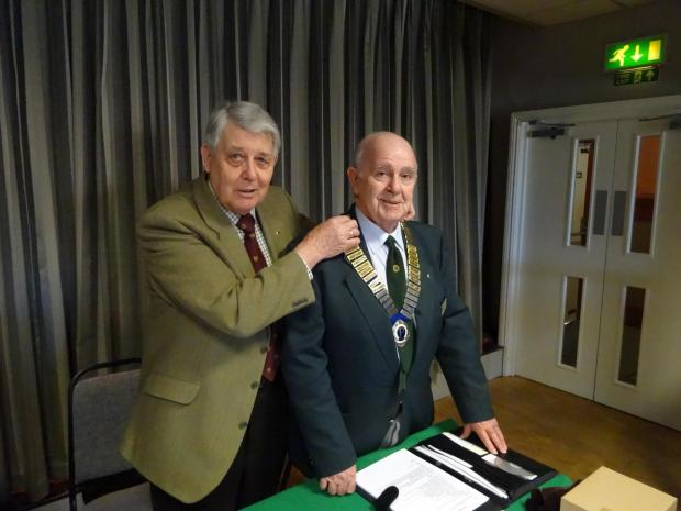 Evesham Journal: Jim Cox is given the chain by outgoing president Bob Young.