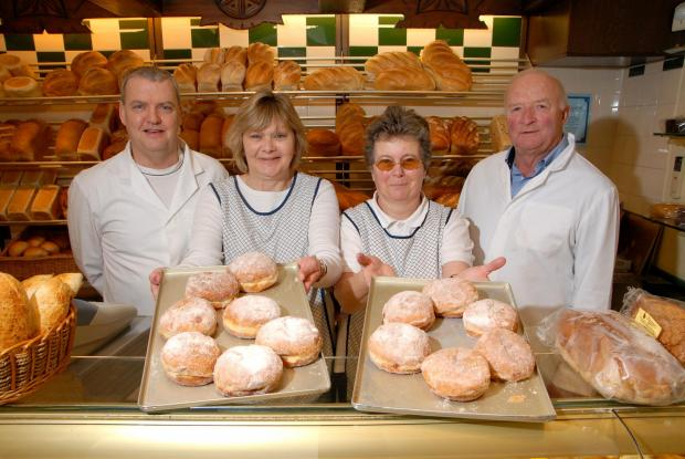 Lawrence's Bakery are celebrating their 60th anniversary. From left - Donald McLellan, manager, Sandra Ireland, June Simmonds, shop assistants and Peter Lawrance, owner. Photo by Paul Jackson (0914528901)