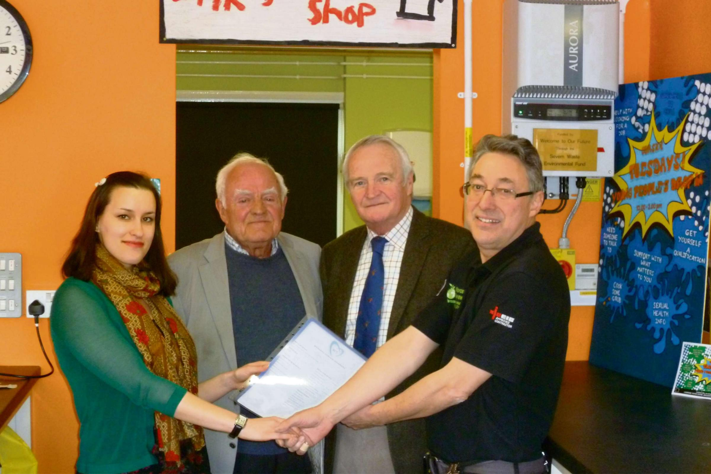 Kirsty Elwell, from Ourside Youth Centre with Councillors Clive Holt and Bob Banks, who donated the money and Gordon Bunker.