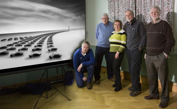 "The Monochrome Gold Medal winning image ""Sweeping"" by Justin Minns from Suffolk. Alongside the screen are the panel of selectors from left to right: Leigh Preston, David Gibbins, Margaret Salisbury, John Chamberlin and Peter Preece."