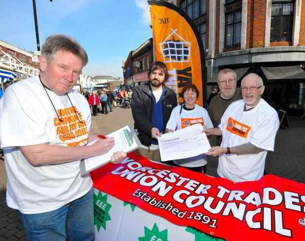 Members of  Worcester Trades Union Council hold a demo in Worcester. (from left) Pete McNally, Mark Davis, Maggie and Andy Fenwick and Bryn Griffiths with a petition to gain fair pay in the public sector workplace.