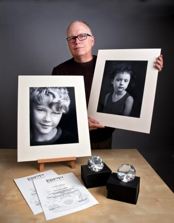 Kevin Smith with his winning photos.