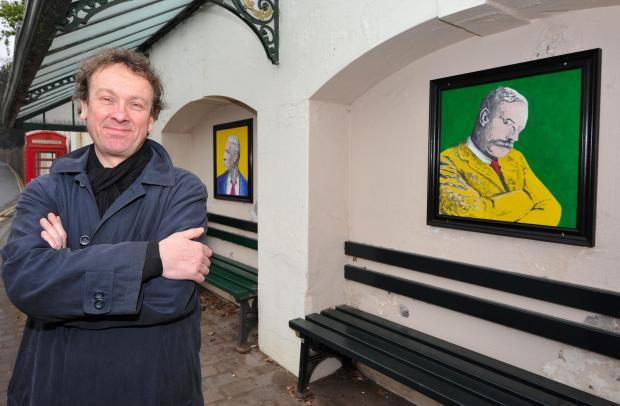 Evesham Journal: John Anyon         2/4/14         14145632Malvern Mayor, Julian Roskams by the bus shelter in Malvern town centre that has been decorated with Elgar paintings. The original art work is to be auctioned off at The Mount Pleasant Hotel on April 10th for th