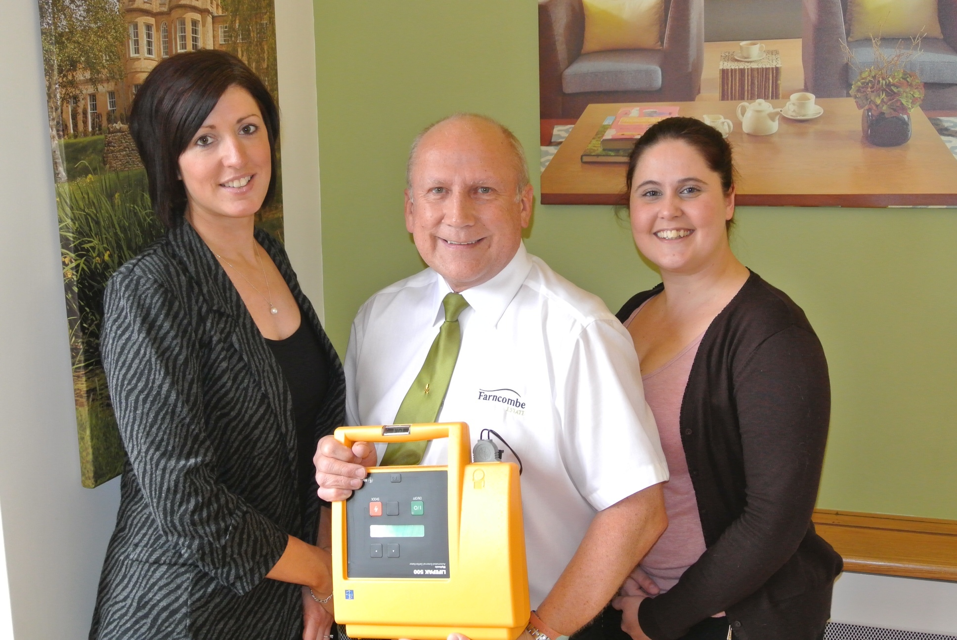 HEROES: Lifesavers Katie Nightingale, Tony Haines and Gemma Guedes with the defibrillator they dashed to fetch.