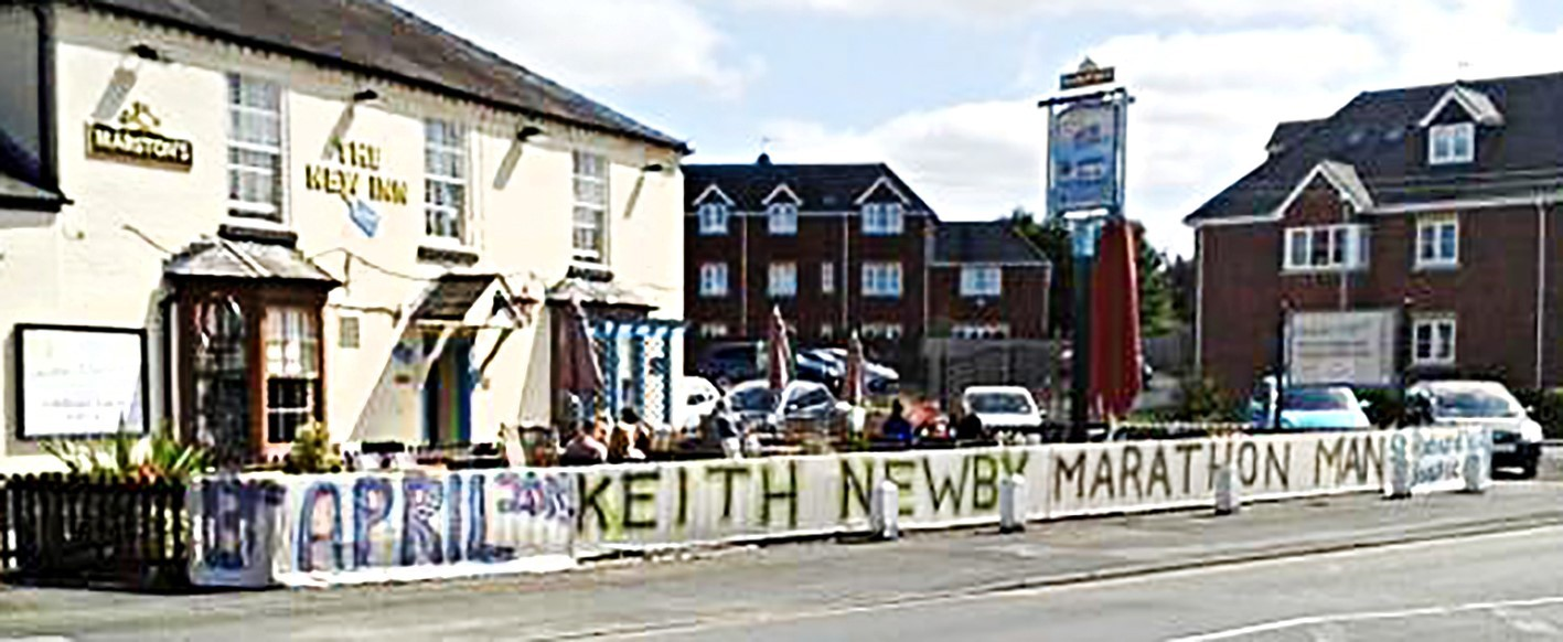 Marathon man: The banner which celebrated Keith Newby's marathon efforts outside The New Inn, Ombersley Road.