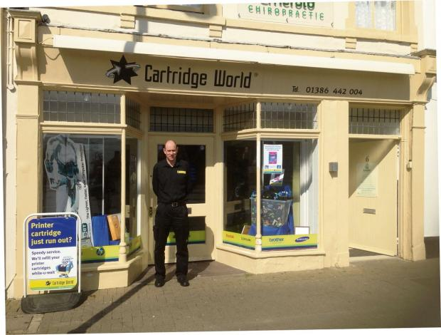 BIGGER AND BETTER: Richard Jones outside Cartridge World
