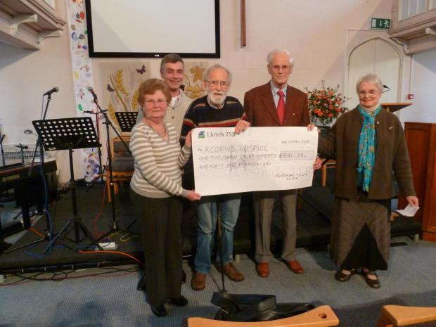 The cheque being presented to Elaine Cox, from Acorns, with (l-r) musical director David Barclay, Ric Hinchliffe, John Hodgkins and Jenifer (CORR) Burton, who spearheaded the calendar campaign.