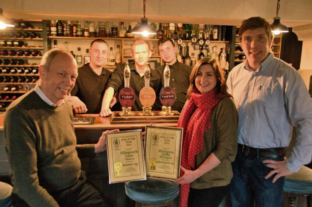 John Bellinger, CAMRA North OXON Chairman, presenting the awards to Claire and Jim Alexander with Yohann Thuillier, Andrew Baker, Manu Serna (back).