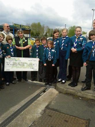 The 1st Pershore Scout Group receiving a donation thanks to the Evesham Journal appeal.