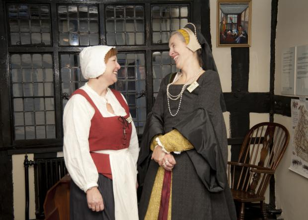 The search is on for volunteers who can don in period costume to greet visitors and share their interest in the city's history.