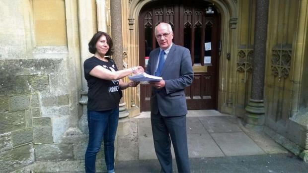Diane Pugh presents the Operation Badger petition to Councillor David Hughes.