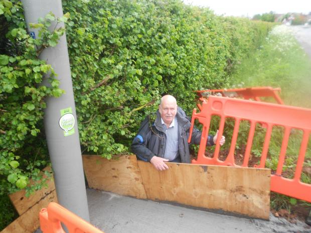 CONCERNS: Dave Harrison next to the concrete base which he fears will result in flooding