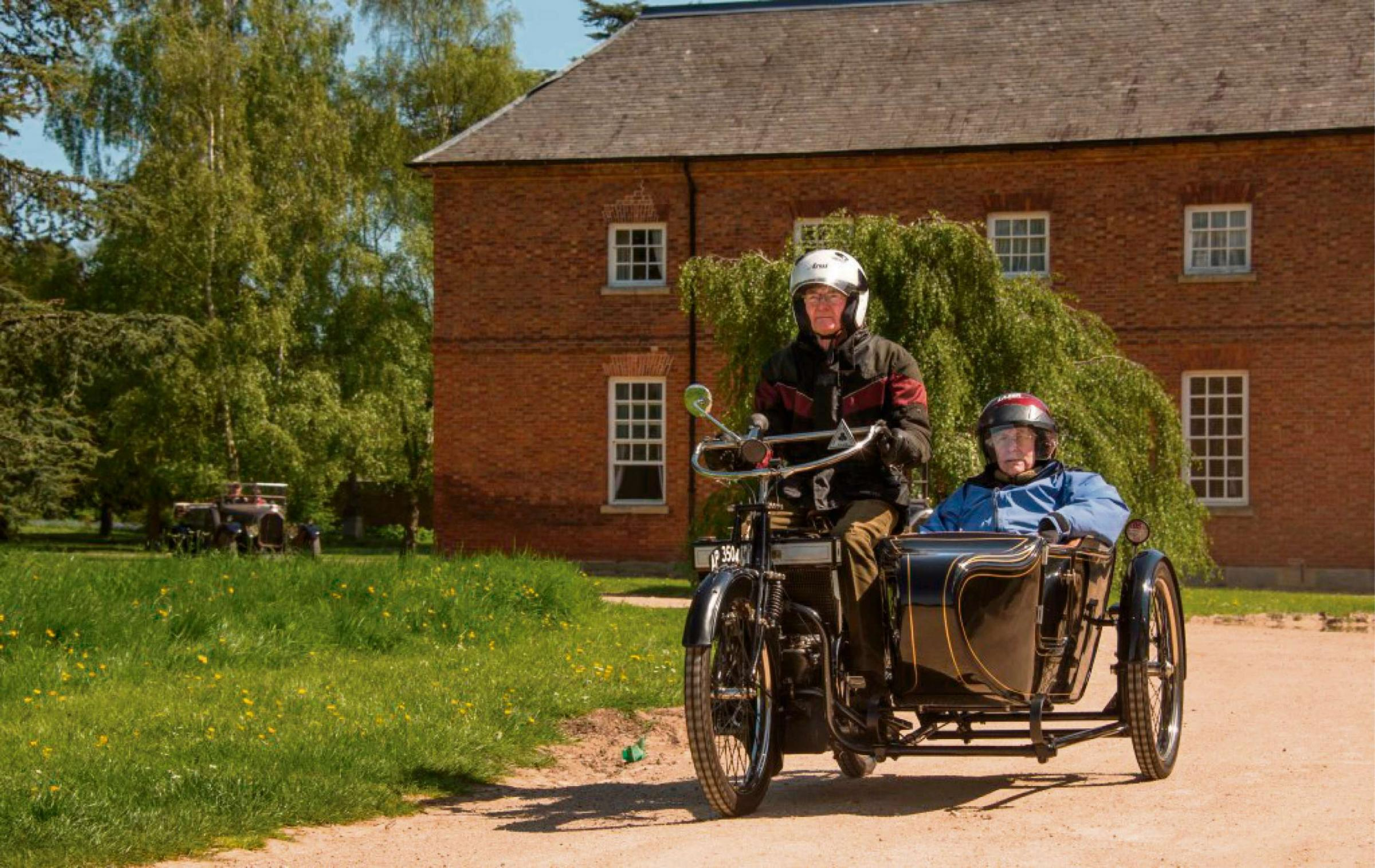 Historic cars parade through Croome parkland