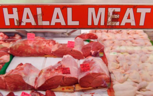 Evesham Journal: General view of a butchers selling halal meat in Brixton, south London, as a review of labelling of halal meat will be conducted if the industry fails to deliver more transparency within the next few months, Downing Street has said. PRESS ASSOCIATION Phot