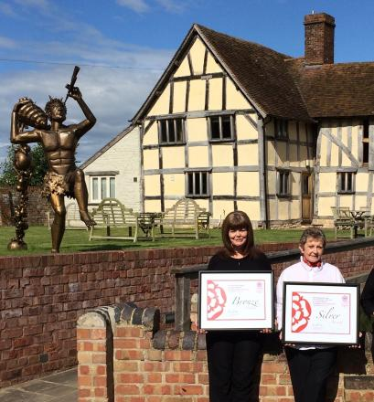 A delighted Eckington Manor Receptionist Tracey Williams (left) and owner Judy Gardner display their certificates after major wins at the VisitEngland Awards for Excellence 2014.