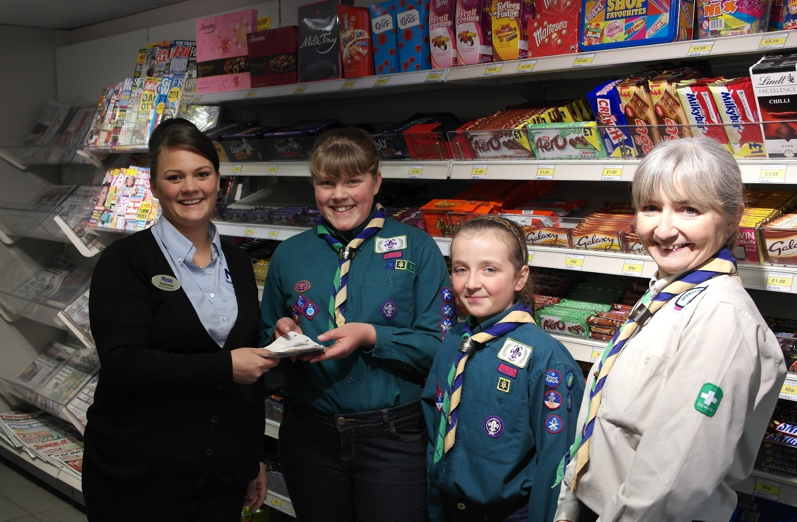 Stephanie Rhoden, Twyning shop manager, with scouts Leah and Amaya and scout leader Lorna Herold.