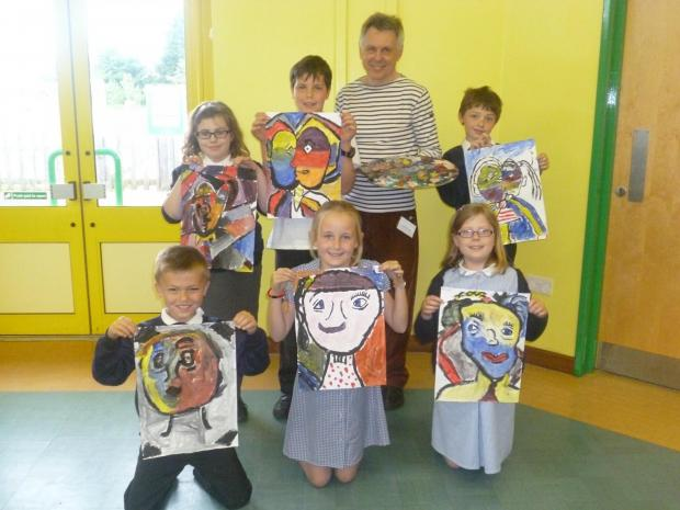 Children at Harvington First and Nursery School enjoy art day. Front row from left: Craig Hopkins, Honey Jagger, Hannah Smith. Back row from left: Lia Scarrott, Tom Merrall, Filbert the artist, Jack Benjamin.