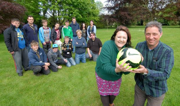 1914592801. 07/05/14. Staff and students at Pershore Agriculture College held a charity football match to raise money for Macmillan Cancer Support. Fundraising manager for Macmillan Kelly Whitehouse and college lecturer Paul Bearcroft, front, with staff a