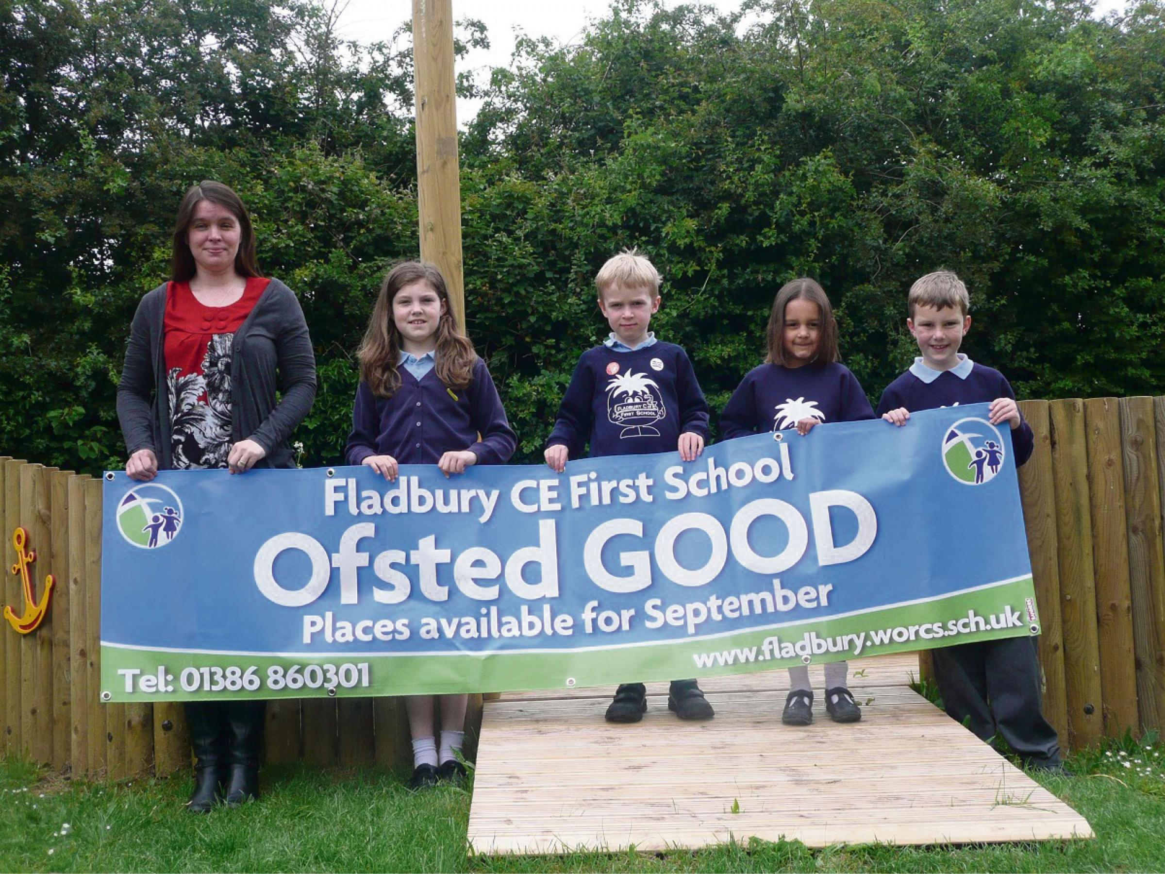 Fladbury CE First School headteacher Julie Wilson and pupils celebrate the school's good Ofsted rating