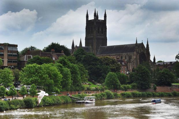 Evesham Journal: Pleasure boats enjoying the views of Worcester Cathedral from the River Severn, under ever darkening skies. Pic Jonathan Barry 28.5.14  2214608001 (6564453)
