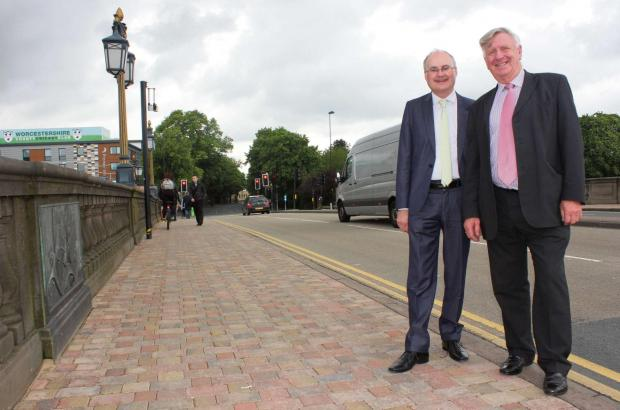 Evesham Journal: Cllr Simon Geraghty, county councillor for the Worcester Riverside division, and cllr John Smith, cabinet member for Highways, on the improved Worcester Bridge where work on an improvement project was completed ahead of schedule overnight May 29/30.