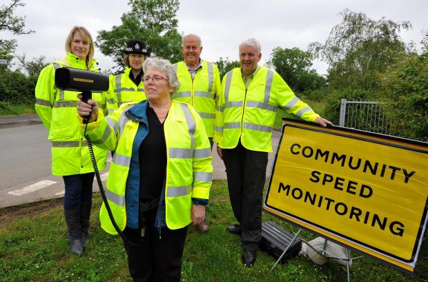 Evesham Journal: John Anyon        30/5/14         2214611001  Safer Roads Partnership traffic speed monitoring at Crowle on Friday......................Resident, Lee Turner with speed camera, Lee Turner , communications Manager with Safer Roads Partnership, Inspector, Ja