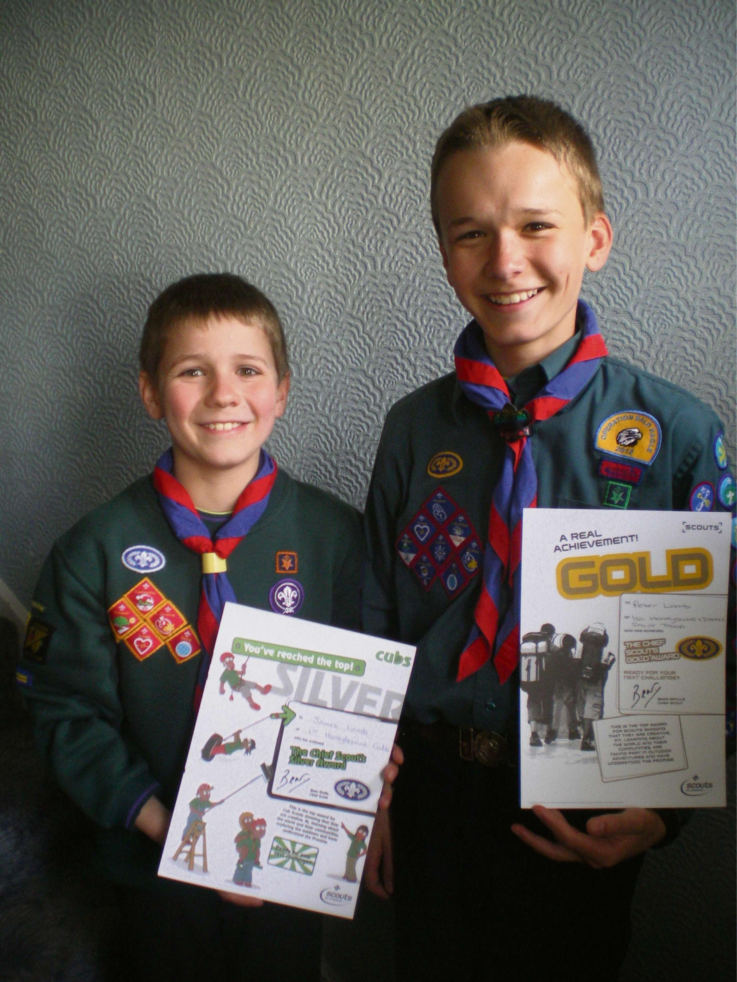James and Peter Lamb celebrate their Scouting awards.